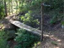 The Cliffhanger bridge at Levis Mounds Trails